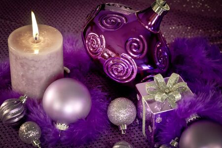 candes: Purple holiday decorations on purple table cloth Stock Photo