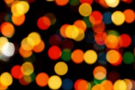 Multi-colored Christmas tree lights bokeh sparkling background at night