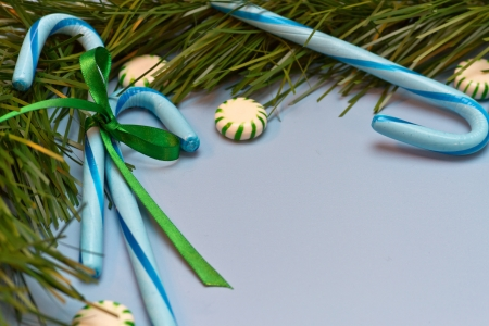 Blue candy canes tied with green ribbon and green striped mints and green garland