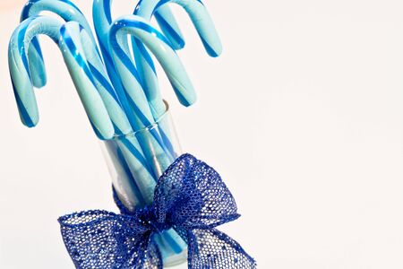 Blue candy canes in glass with blue ribbon Stock Photo