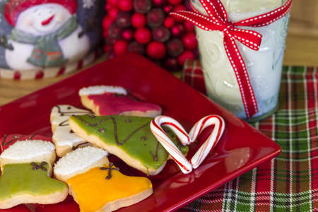 Holiday decorated cookies and milk for Santa with a candy cane heart photo