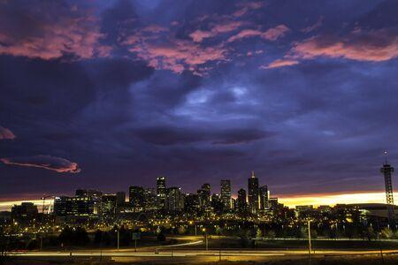 denver skyline at sunrise: Dramatic sky sunrise over Denver skyline in the early morning Stock Photo