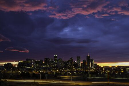 Dramatic winter sunrise sky over Denver skyline photo
