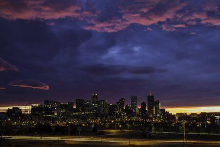 denver skyline at sunrise: Dramatic winter sunrise sky over Denver skyline