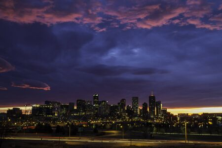 Pink and blue dramati sunrise sky of the city of Denver Colorado photo
