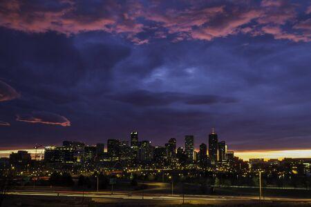 denver skyline at sunrise: Pink and blue dramati sunrise sky of the city of Denver Colorado