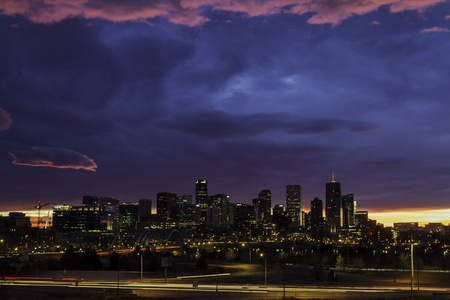 Denver skyline at sunrise with dramatic colors in the sky