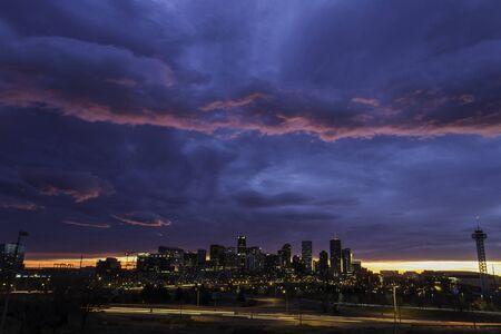 capital of colorado: Colorful Colorado sunrise over the city of Denver skyline Stock Photo