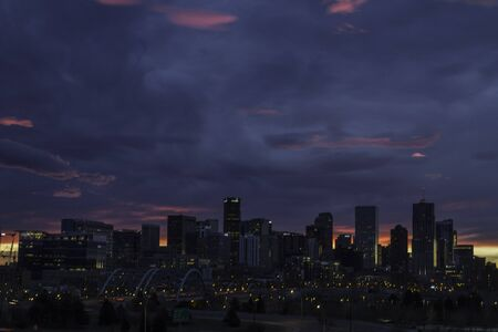 Early morning dramatic sunrise over Denver Colorado skyline photo
