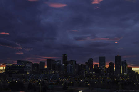 Dramatic and colorful cloud at sunrise over the skyline of Denver Colorado photo
