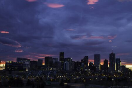Denver skyline at sunrise with colorful clouds photo