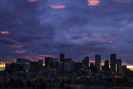 denver skyline at sunrise: Pink, orange and blue sunrise over the ciyt skyline of Denver Colorado