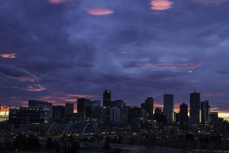 Skyline of Denver Colorado at sunrise with dramatic colorful sky photo