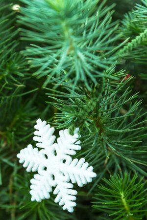 Evergreen Christmas tree with white glitter snowflake
