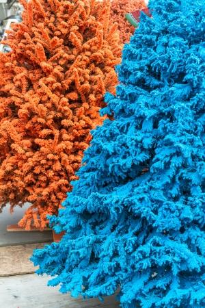 flocking: Blue and orange flocked Christmas trees
