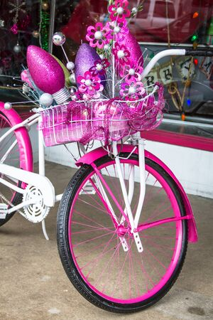 cruiser bike: Hot pink and white bike decorated for Christmas Stock Photo