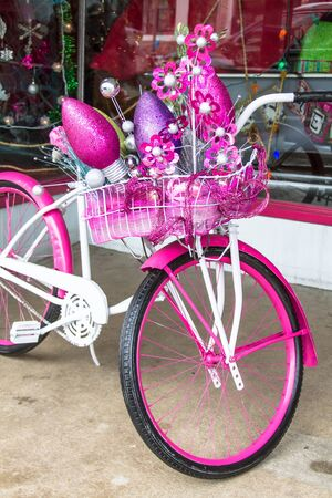pink cruiser: Christmas decorations on a pink and white bike Stock Photo
