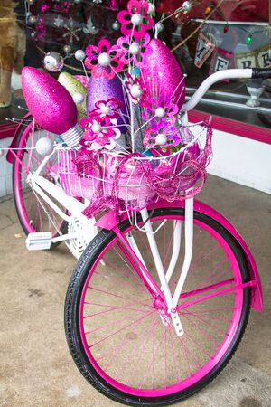 pink cruiser: Holiday decorated pink and white bike Stock Photo