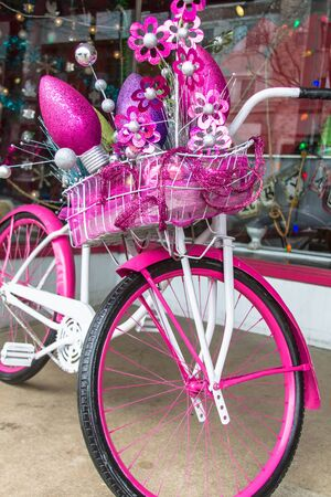 Pink and white cruiser bike decked out for Christmas photo