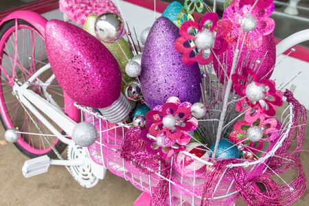 pink cruiser: Christmas decorations on pink and white cruiser bike Stock Photo