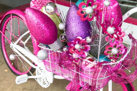 pink cruiser: Holiday decorations on a pink and white cruiser bike