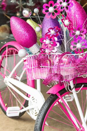 pink cruiser: Christmas decorated pink and white bike