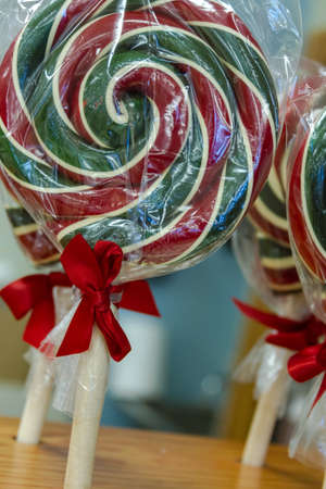 Red and green packaged lollipops