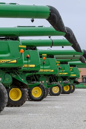 Row of large John Deere farm machines