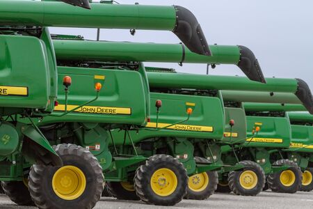 deere: Row of large John Deere farm machines