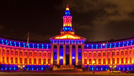 playoffs: 2013 Denver City and County Building special lighting in Denver Broncos orange and blue for the 2013 NFL Playoffs