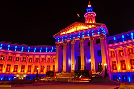 2013 Denver City and County Building special lighting in Denver Broncos orange and blue for the 2013 NFL Playoffs Stock Photo - 17298266
