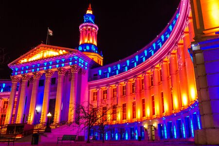 2013 Denver City and County Building special lighting in Denver Broncos orange and blue for the 2013 NFL Playoffs Stock Photo - 17298272