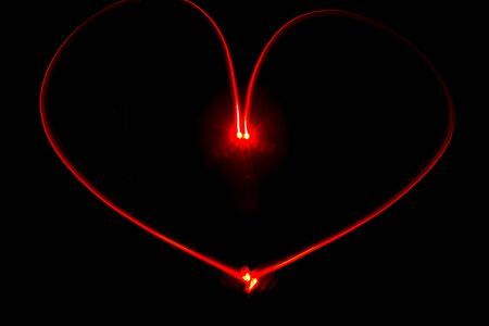 Light painting red heart with streaks of red light