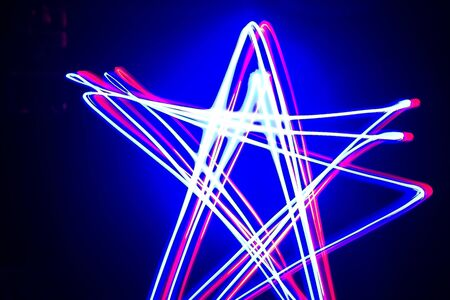 Blue and red light star shapes and streaks made by light painting