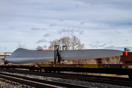 Single wind energy turbine blade on frieght train ready for transport Stock Photo - 17403142