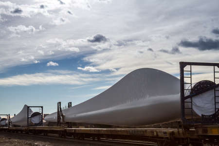 Close up of wind energy turbine blades on train waiting for transport Stock Photo - 17402221