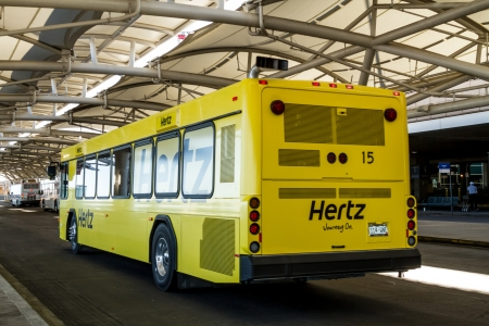 Hertz yellow car rental buses drop off and pickup at Denver International Airport Stock Photo - 17403470