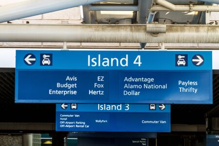Car rental directional signs at busy airport