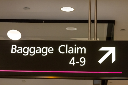 denver co: Baggage claim directional sign at airport