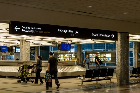 denver co: Baggage claim with airport directional signs above Editorial