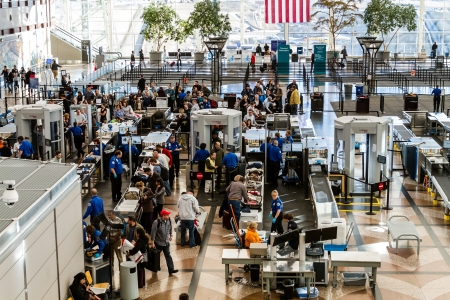 People waiting in line at TSA checkpoint security at airport Stock Photo - 17435525