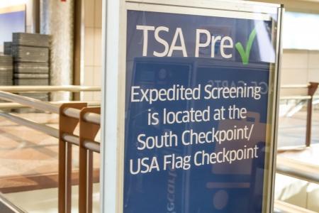 denver co: TSA Pre Check in Expedited Screening sign at airport