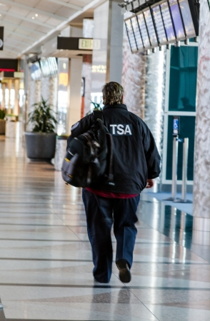 TSA Agent walking down corridor at airport