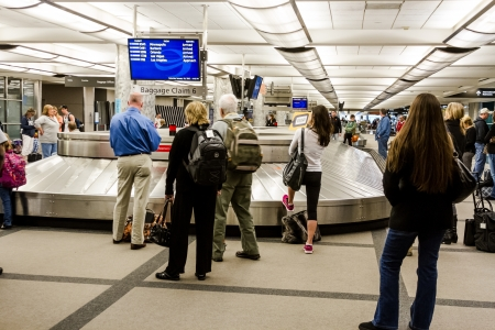 People waiting for luggage at baggage claim carousel