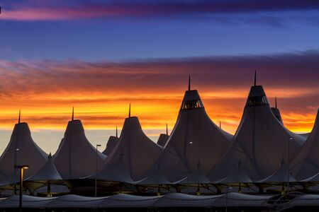 Orange and blue Bronco sunset over the tents of DIA