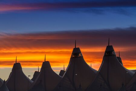 denver co: Orange and blue Bronco sunset over the tents of Denver International Airport Editorial
