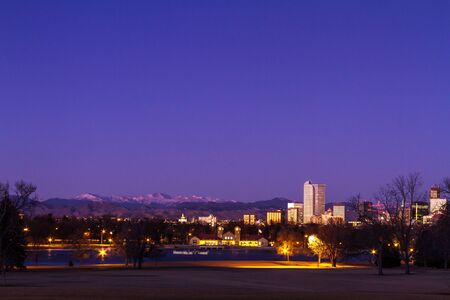 city park boat house: Denver Colorado skyline at sunrise, during winter, from City Park and Denver Museum of Science and Nature