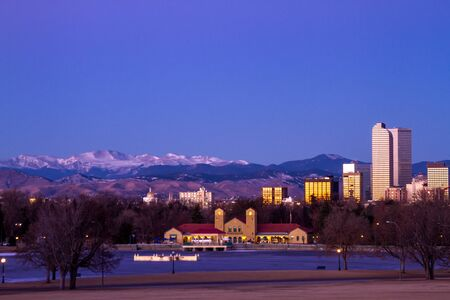 denver skyline at sunrise: Denver Colorado skyline at sunrise, during winter, from City Park and Denver Museum of Science and Nature