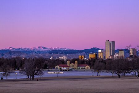 january sunrise: Denver Colorado skyline at sunrise, during winter, from City Park and Denver Museum of Science and Nature