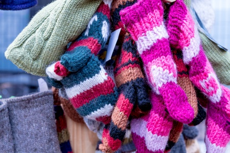 mile high holidays: Bright colored hats and mittens for sale at the Denver Christkindl Market